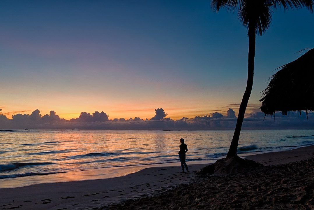 Dominican Republic, Beach, Palm Tree, Sunset, Woman, Solo Traveler, Traveler, Single, Singles Holidays, Singles Vacations, Travel Insurance (Image: MustangJoe, Pixabay)
